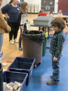 Rondout student looking at the new zero waste storing station