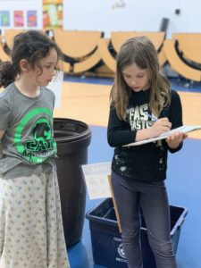Two Rondout students conduct a waste audit on launch day.